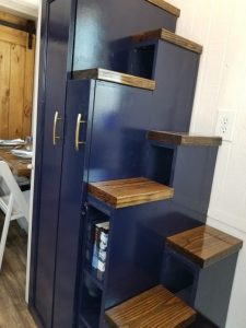 Stairs over ladders helps with storage space in a small home