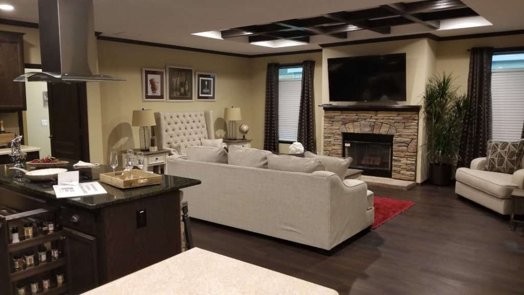 Living in a mobile home living room with fireplace