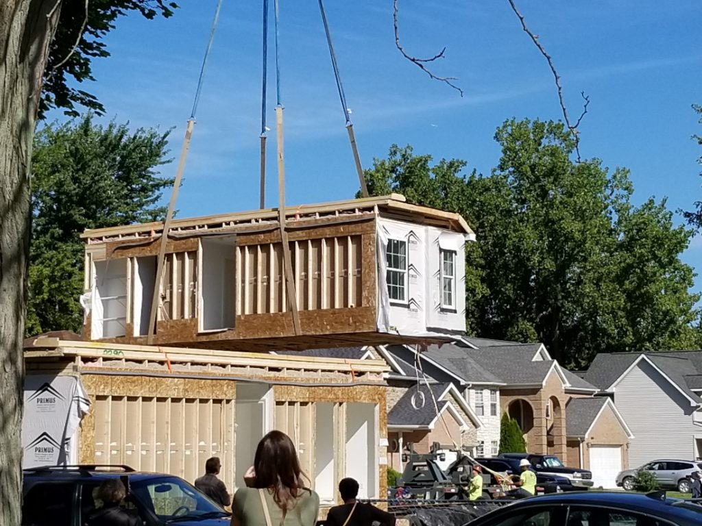 new Romulus modular home lifted and set